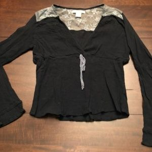 Free People top with lace. Gently used condition.